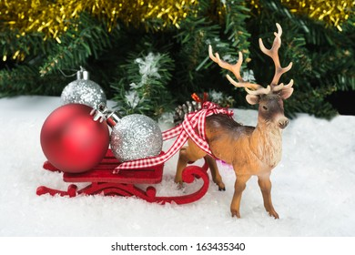Christmas balls on Red Sledge and reindeer