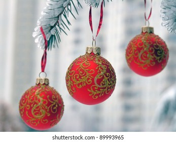 Christmas balls on the snow-covered spruce