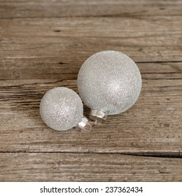 christmas balls on wooden background
