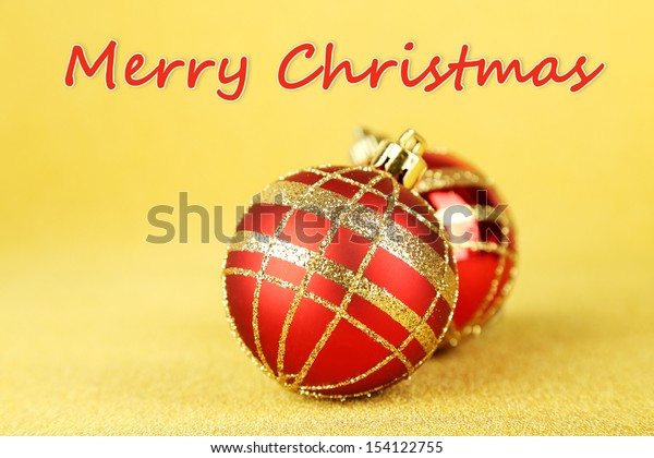 Christmas balls on yellow background