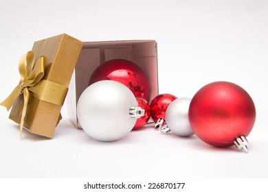 Christmas balls out of a gift box