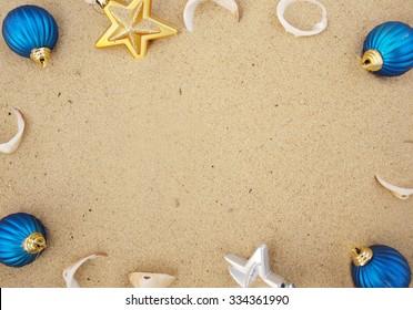 christmas balls in sand