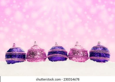 Christmas balls in snow, christmas background with bokeh, snowflakes, stars, Festive banner