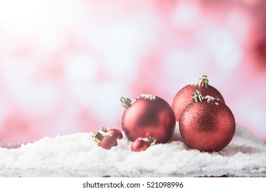 christmas balls in snow,ligths bokeh background