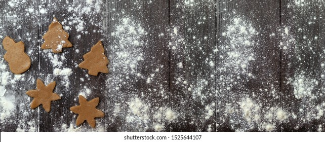 Christmas banner with cookies or attribute on brown wooden background. Top view, copy space, no people