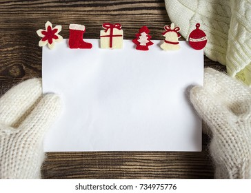 Christmas banner. Letter to Santa Claus. Wish list. Winter background. Hands in mittens.