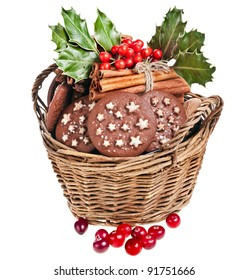 christmas basket full cookies holly berries on a white background