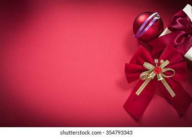 Christmas bauble knot present box on red background holidays concept. - Shutterstock ID 354793343