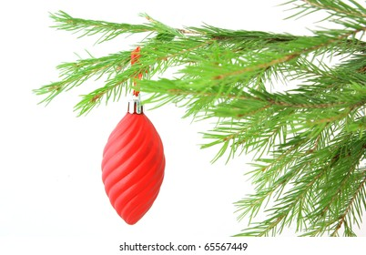 Christmas bauble on firtree branch isolated