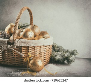 christmas baubles in the basket with copy space, retro toned