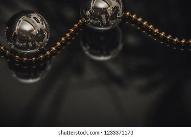 Christmas baubles and golden tree chain. Motive with two baubles and chain for cards and backrounds.