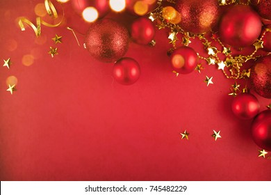 Christmas baubles on red glitter background