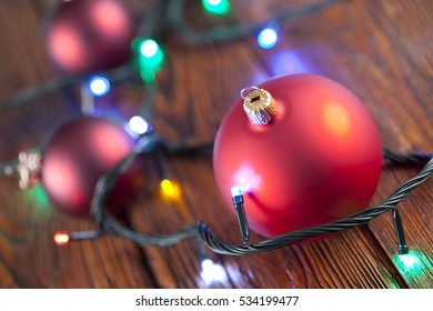 Christmas baubles on wooden table