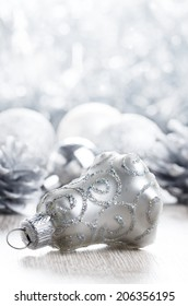 Christmas baubles over bright background