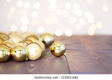 Christmas baubles with christmas tree lights on wooden background