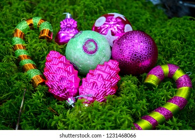 Christmas baubles view. Merry Christmas balls and baubles on green moss. Christmas baubles on forest green moss. Christmas balls view