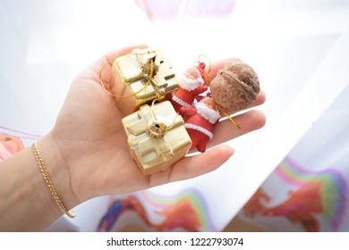 Christmas beautiful decoration, one hand with objets for holidays