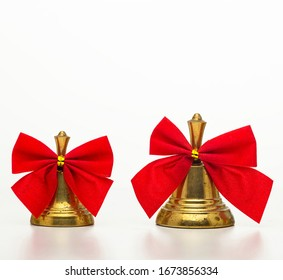 Christmas bell with a red bow isolated on white background