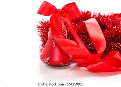 Christmas bell with red ribbon on white background