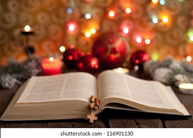 Christmas and bible with blurred candles light background