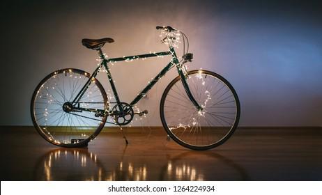 Christmas bicycle. Bike decorated with christmas lights
