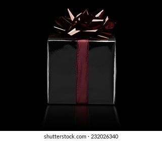 christmas or birthday gift wrapped with red bow
