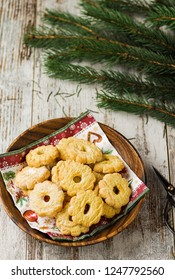 Christmas biscuits on wooden background and branches of fir on the top.