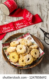 Christmas biscuits on wooden background and red ribbon