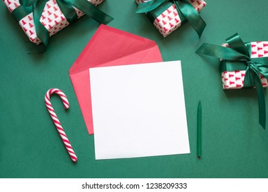 Christmas blank for letter to Santa on green. Invitation. Space for wishes. View from above.