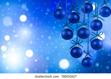 Christmas blue balls with ribbons on defocused background
