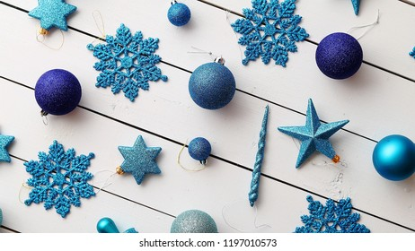 Christmas blue collection, balls and decorative ornaments, on white wooden background.