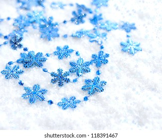 Christmas blue snowflakes of decoration on snow