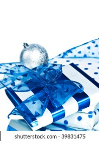 christmas blue and white gifts and silver ball