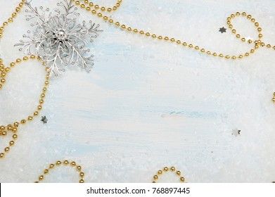 Christmas blue wooden background with snowflake