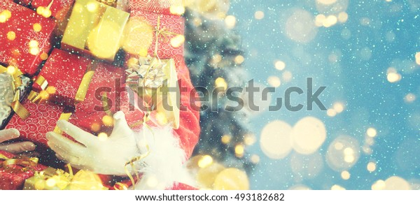 Christmas blurred background, Santa with gifts