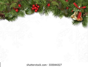 Christmas border branches and holly on white background