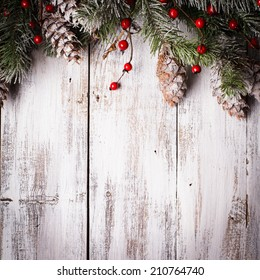 Christmas border design with snow covered pinecones