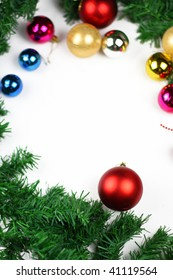 Christmas border of evergreen, ornaments,