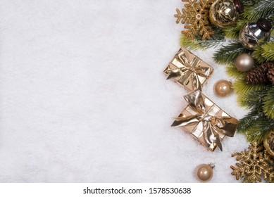 Christmas border flat lay with pine, presents and snow. Cristmas and New Year holiday background.