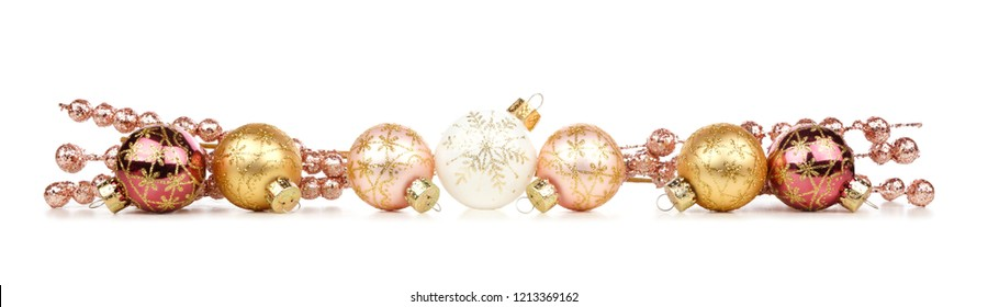 Christmas border of gold and copper decorations isolated on a white background