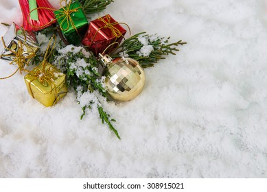 Christmas border with ornament, golden present and snow,Christmas team