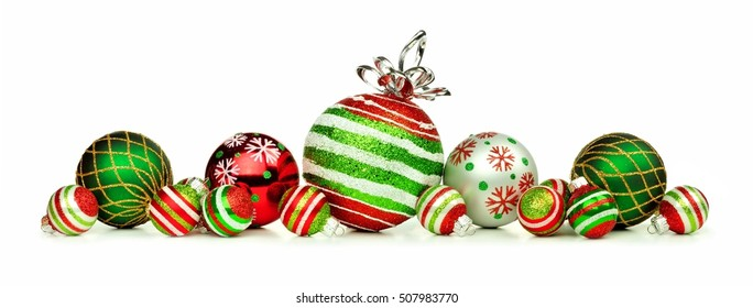 Christmas border of red, green and white ornaments isolated on a white background