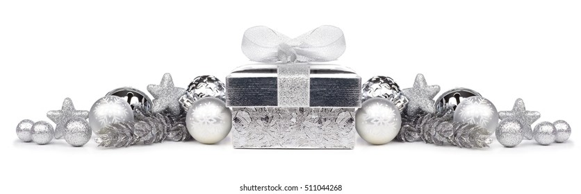 Christmas border of silver ornaments and gift isolated on a white background