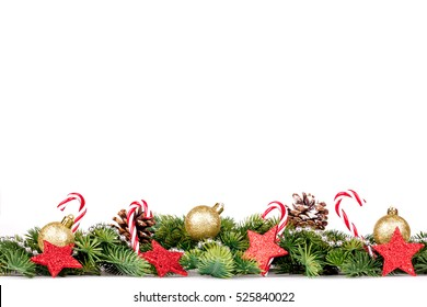 Christmas Border - tree branches with golden balls, candy and big star isolated on white
