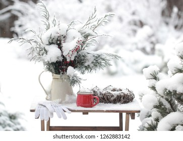 Christmas bouquet and a red Cup of tea in the snow garden