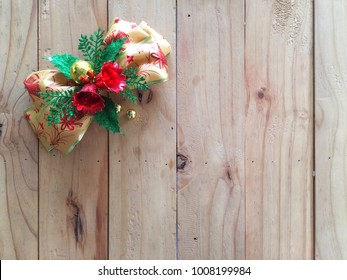 Christmas bow on wooden background