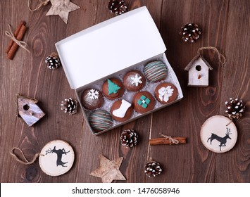 Christmas box of chocolate cake pops with some Christmas stuff near it