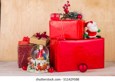 Christmas box with gifts on a wooden table