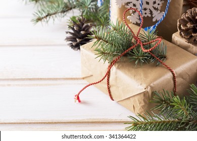 Christmas Boxes, Coniferous, Pine Cones on Lighten Wooden Table. Selective Focus Place for Text.