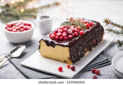 Christmas breakfast. Cottage  cake with cranberries and New year  decorations on a light background.
